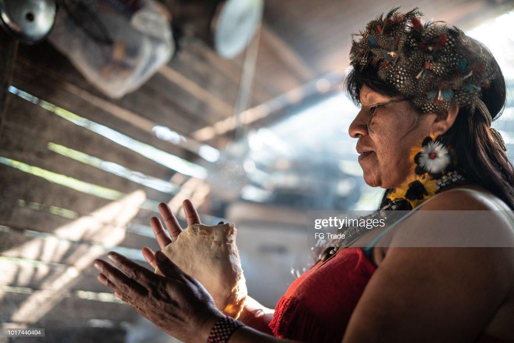 "Indigenous Brazilian Woman, from Guarani Ethnicity, Cooking ""Xipa"" : Stock Photo"