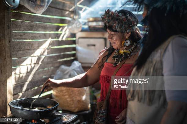 "Indigenous Brazilian Women, from Guarani Ethnicity, Cooking ""Xipa"""