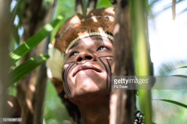 Indigenous Brazilian Young Man Exploring the Rainforest - from Guarani Ethnicity