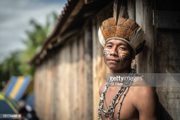 indigenous brazilian young man portrait from guarani ethnicity at home - indigenous culture stock pictures, royalty-free photos & images