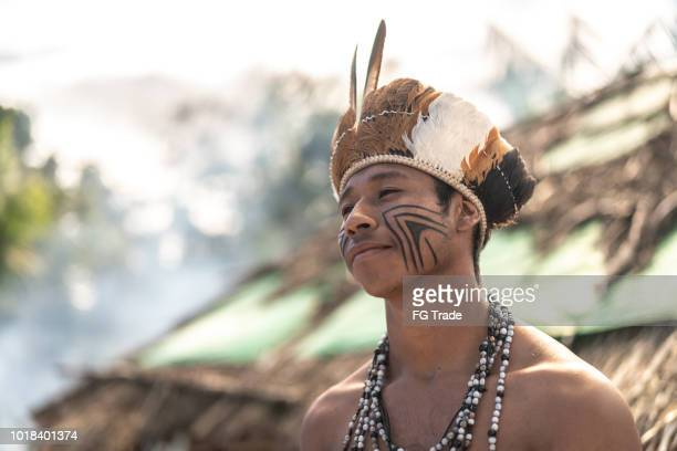 indigenous brazilian young man portrait from guarani ethnicity - handsome native american men stock pictures, royalty-free photos & images