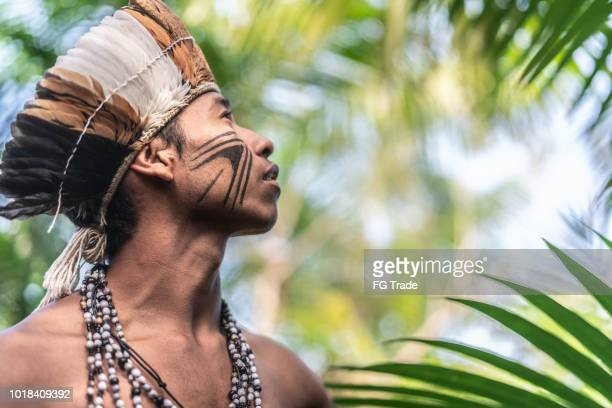indigenous brazilian young man portrait from guarani ethnicity - indigenous culture stock pictures, royalty-free photos & images