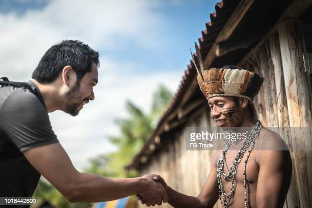 indigenous brazilian young man portrait from guarani ethnicity, welcoming the tourist - humility stock pictures, royalty-free photos & images