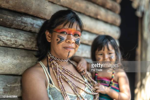 indigenous brazilian young woman and her child, portrait from tupi guarani ethnicity - indigenous culture stock pictures, royalty-free photos & images
