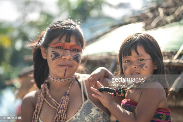 indigenous brazilian young woman and her child, portrait from tupi guarani ethnicity - manaus stock pictures, royalty-free photos & images