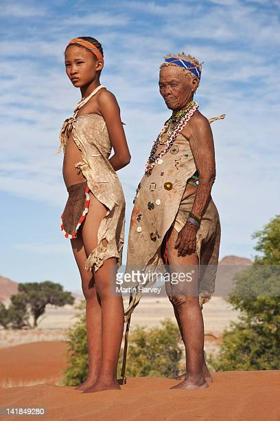 indigenous bushman/san girl and grandmother (14years old, 75 years old), namibia (image taken to raise awareness and funds for the conservation projects of n/aâ¿an ku s㪠organisatio - 14 15 years stock pictures, royalty-free photos & images