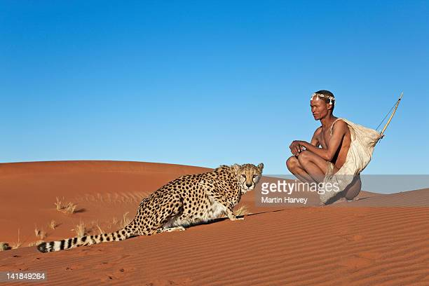 Indigenous Bushman/San hunter (43 years old) hunting with cheetah (Acinonyx jubatus), Namibia (Image taken to raise awareness and funds for the conservation projects of N/a'