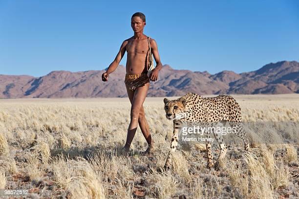 Indigenous Bushman/San hunter with cheetah.