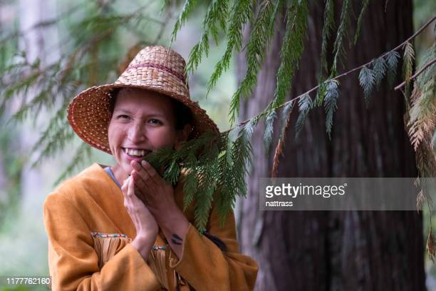 indigenous canadian woman blessing the trees - first nations stock pictures, royalty-free photos & images