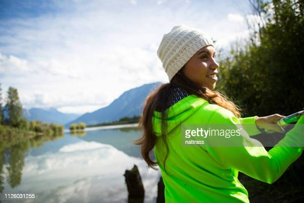 indigenous canadian woman fishing - inuit stock pictures, royalty-free photos & images