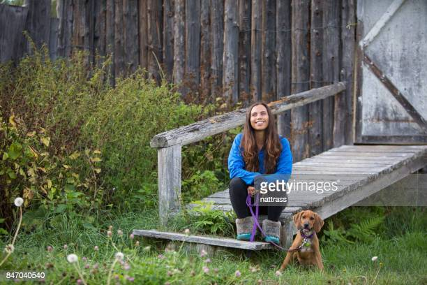 Indigenous Canadian woman sits with her dog