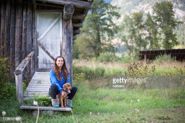 indigenous canadian woman sitting with her pet dog - first nations stock pictures, royalty-free photos & images