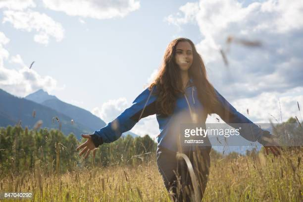 Indigenous Canadian woman walks through a lovely field