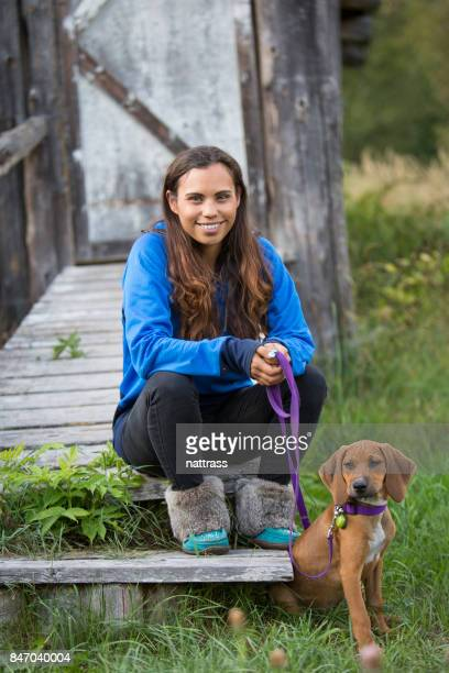 indigenous canadian woman with her pet dog - first nations stock pictures, royalty-free photos & images