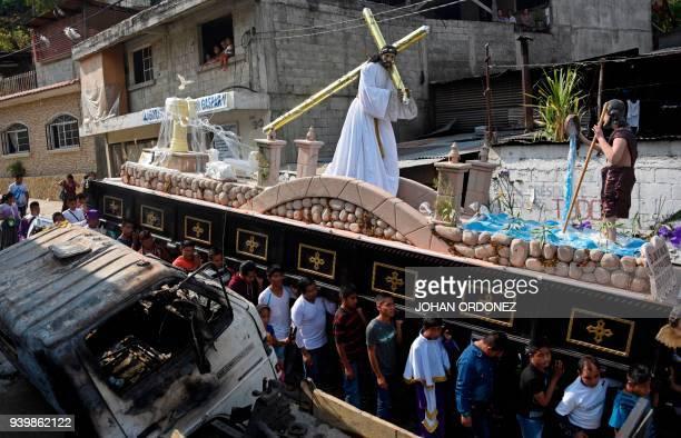 Indigenous catholic devotees take part in the Justo Juez procession within Holy Week celebrations, in Chinautla municipality 15 km north of Guatemala...