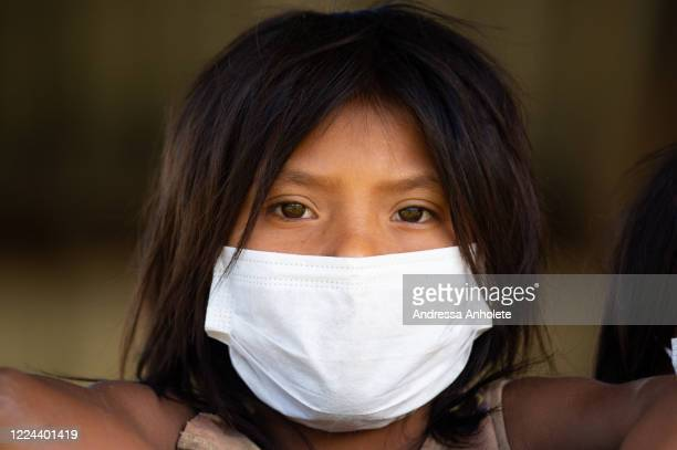 Indigenous child wears protective mask to receive health care during the Yanomami / Raposa Serra do Sol Mission amidst the coronavirus pandemic at...