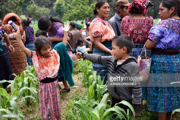 Indigenous children plays in the village of Los Mendoza San Juan Ostuncalco municipality Quetzaltenango department 115 km west of Guatemala City at...