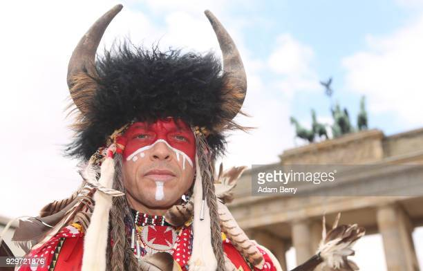 Indigenous Dancer and Drummer Bryce Morison poses while performing with the Calgary Stampede at the Brandenburg Gate as the group visits Germany to...