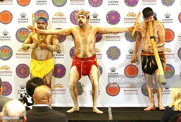 Indigenous dancers perform on stage during the launch of Crown Resorts' second Reconciliation Action Plan on July 31 2015 in Melbourne Australia...