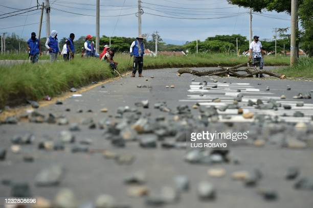 Indigenous demonstrators block the Panamerican highway during a protest against the government triggered by a now abandoned tax reform bill, in Cali,...
