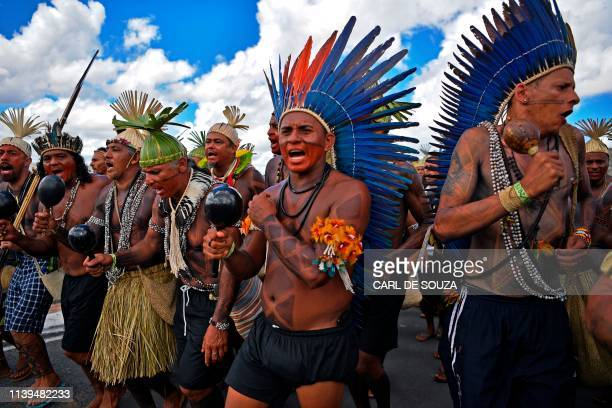 Indigenous demonstrators march in Brasilia on April 26 2019 on the last day of a protest to defend indigenous land and rights Thousands of indigenous...