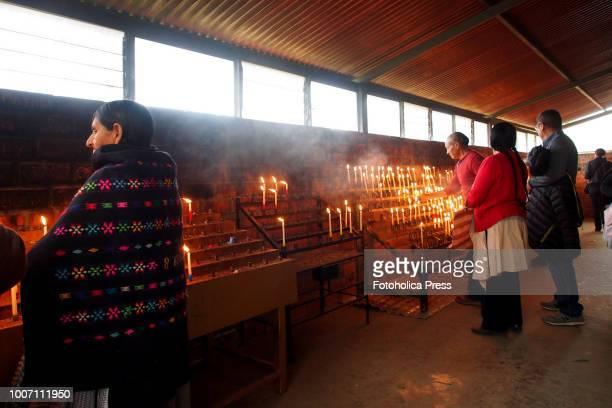 SAPALLANGA HUANCAYO JUNIN PERU Indigenous devotees lighting candles for the Virgin of Cocharcas in the church of Sapallanga in Huancayo city at the...