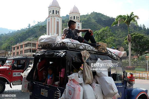 Indigenous Emberos get on a Willys jeep with their bagful of needed commodities hanging from exterior's body in the main square on January 20 2016 in...