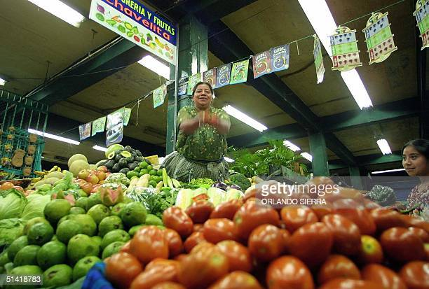 Indigenous farmer Isabel Perez is seen selling her produce in Guatemal City 07 November 2002 as the government has imposed a stall on all imported...