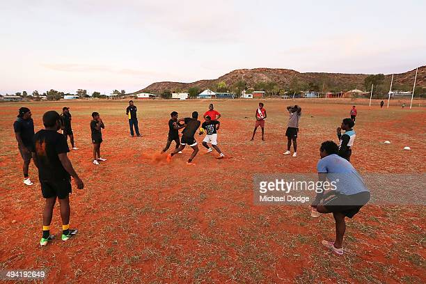 Indigenous footballers contest for the ball during a Santa Teresa Football Club training session on May 28 2014 in Alice Springs Australia This...