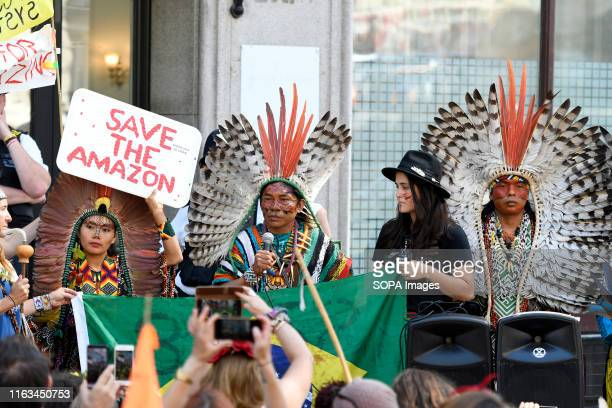 Indigenous from Brazil are seen giving a speech outside the Brazilian embassy in London Extinction Rebellion environmental activists gathered outside...