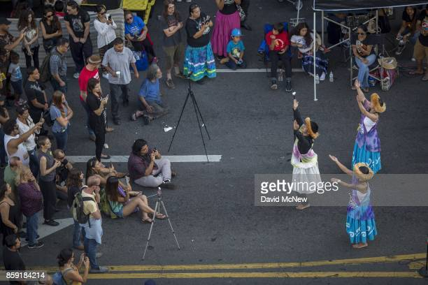 Indigenous Hawaiian dancers perform on Hollywood Boulevard during an event celebrating Indigenous Peoples Day which is set to replace Columbus Day in...