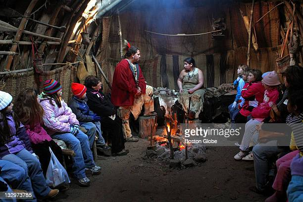 Indigenous James Hackansan and Melanie Deetz in the center of a nush wetu a free fire home talk to a group of school children about life on the...