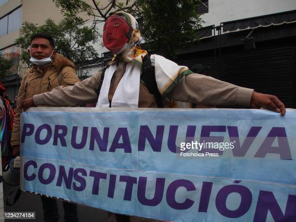 Indigenous man carrying a banner when on the day of Pedro Castillo's presidential inauguration his supporters take to the streets to demand a new...