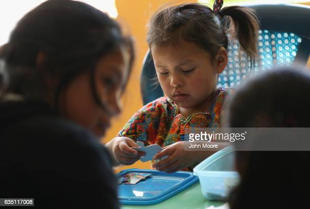 Indigenous Mayan Mamspeaking children play after taking part in a reading circle at the Grupo Cajola library on February 12 2017 in Cajola in the...