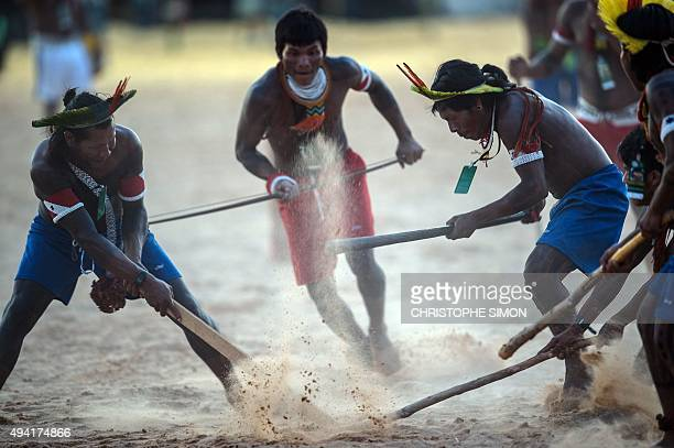 Indigenous men compete during the I World Indigenous Games in Palmas Tocantins on October 24 2015 AFP PHOTO / CHRISTOPHE SIMON