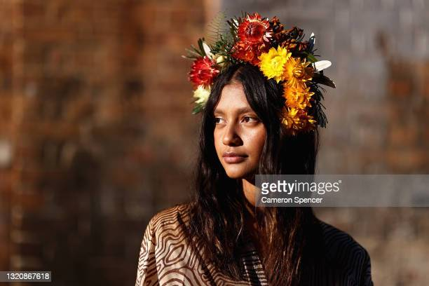 Indigenous model Lisa Fatnowna poses at the Welcome To Country for Afterpay Australian Fashion Week 2021 at the Blacksmith's Workshop, Carriageworks...