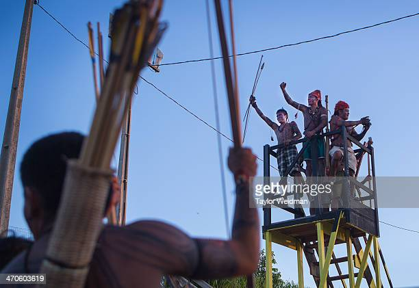 Indigenous Munduruku men cheer during an occupation of the Belo Monte Dam On May 27th an indigenous group made up predominantly of Munduruku occupied...