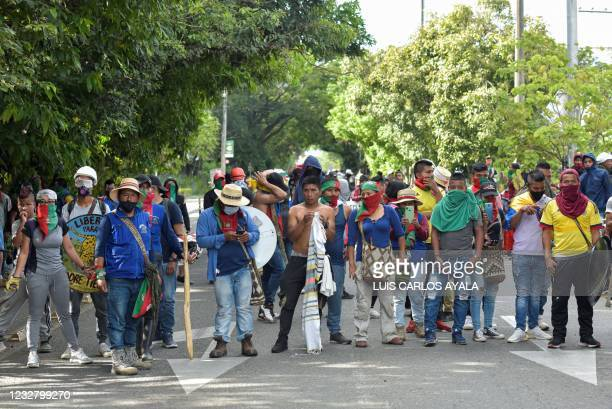 Indigenous people are seen during clashes with citizens who oppose blockades set by demonstrators during protests triggered by a now abandoned tax...