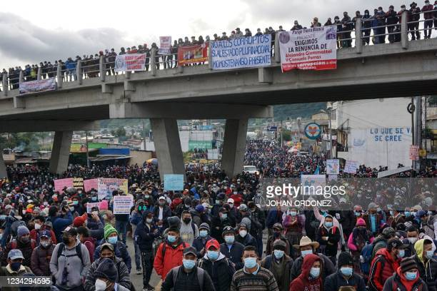 Indigenous people block a road demanding the resignation of Guatemalan President Alejandro Giammattei and Guatemala's Attorney General Consuelo...