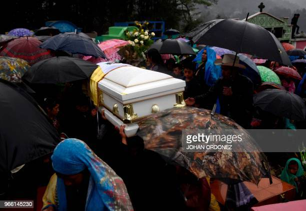 Indigenous people carry the coffin of Claudia Gomez a 19yearold Guatemalan woman who was allegedly shot and killed by a US border patrol agent during...