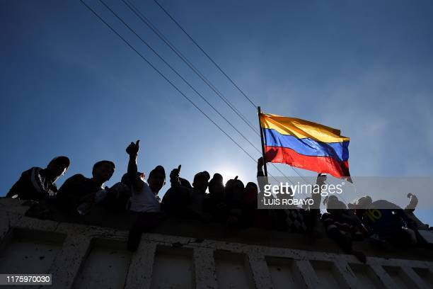 TOPSHOT Indigenous people celebrate on a truck as they leave the Casa de la Cultura in Quito on October 14 after Ecuador's president and indigenous...