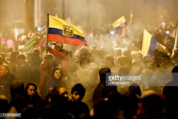 Indigenous people celebrate outside the Casa de la Cultura in Quito on October 13, 2019 after Ecuador's president and indigenous leaders reached an...