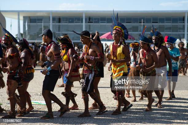 Indigenous people chant slogans during a demonstration to protect their land on August 25, 2021 in Brasilia, Brazil. Over 6,000 indigenous people...