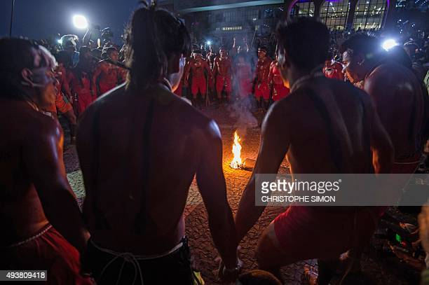 Indigenous people dance around a bonfire on the eve of the beginning of the first World Indigenous Games in Palmas Tocantins Brazil on October 22...
