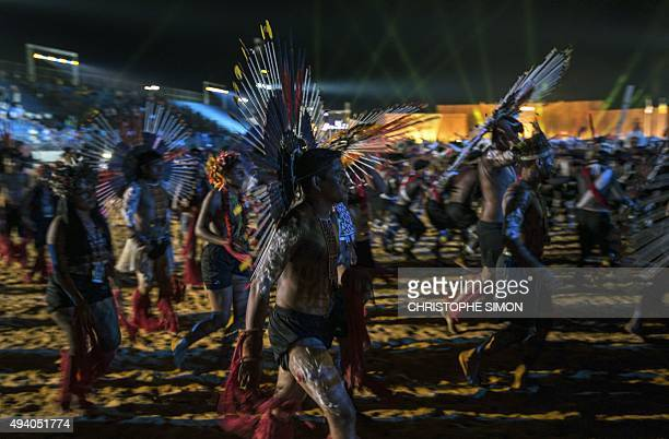 Indigenous people dance during the I World Indigenous Games opening ceremony in Palmas Tocantins on October 23 2015 AFP PHOTO / CHRISTOPHE SIMON