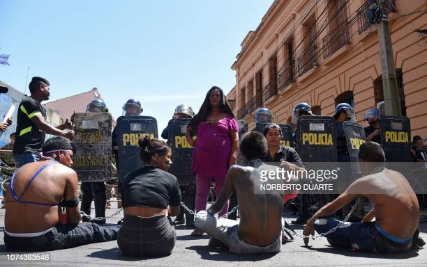 Indigenous people demonstrate in front of the presidential palace in Asuncion on December 18 2018 to demand the resignation of the president of the...