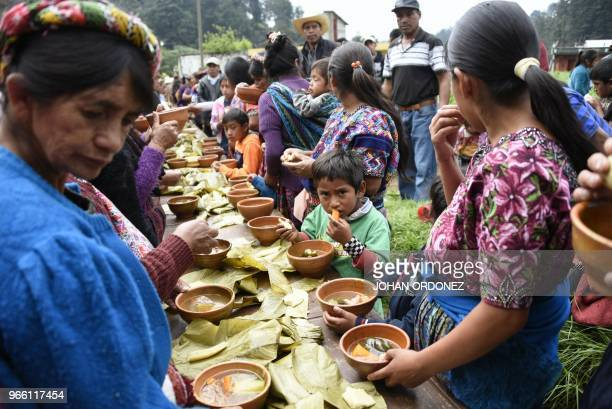Indigenous people eat before the burial of Claudia Gomez a 19yearold Guatemalan woman who was allegedly shot and killed by a US border patrol agent...