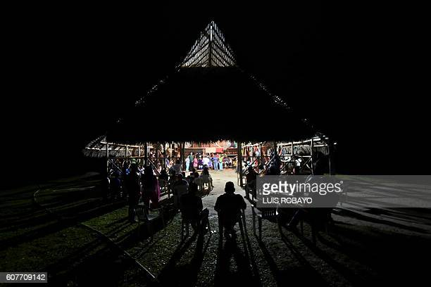 Indigenous people from Colombia's Amazonas department meet in a longhouse to discuss how to save their culture and territories during the First...