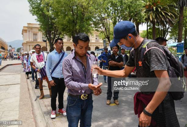 Indigenous people from the Altos de Chiapas queue keeping social distancing while waiting for an allowance from the local government due to the...