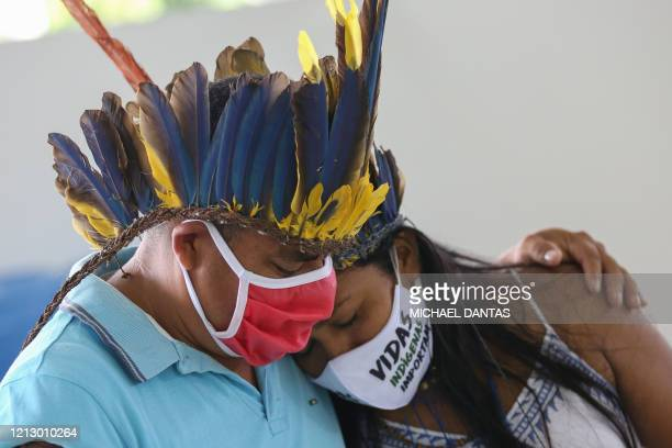 Indigenous people from the Parque das Tribos community mourn at the funeral of chief Messias of the Kokama tribe, who died from the new coronavirus,...